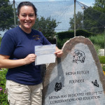 Photos of Heather holding donation check for Back to the Wild