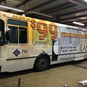 image of city buss with Sandusky Lasik promo image on side