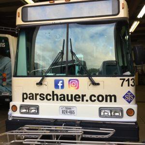 image of city buss with Sandusky Lasik promo image on front